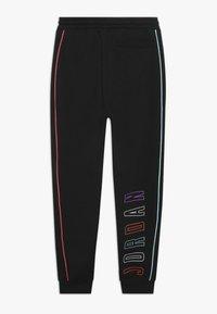 Jordan - AIR FUTURE TAPED PANT - Pantaloni sportivi - black - 1