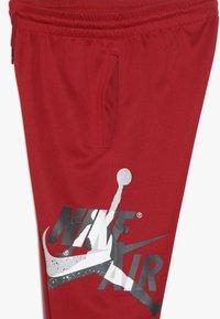 Jordan - JUMPMAN CLASSIC III SUIT PANT - Trainingsbroek - gym red - 3