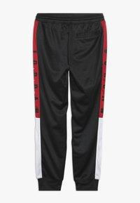 Jordan - SIDELINE JOGGER - Spodnie treningowe - black - 1