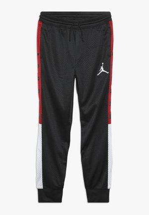SIDELINE JOGGER - Tracksuit bottoms - black