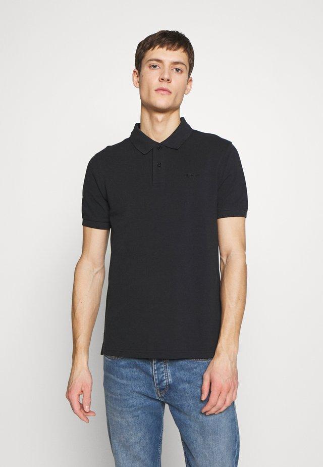 BEEKE - Poloskjorter - black