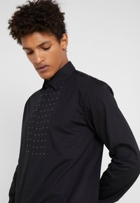 John Richmond - SHIRT SOFIA - Košile - black - 3