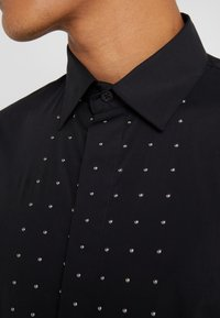 John Richmond - SHIRT SOFIA - Košile - black - 6