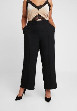 JRRIO PANTS - Trousers - black