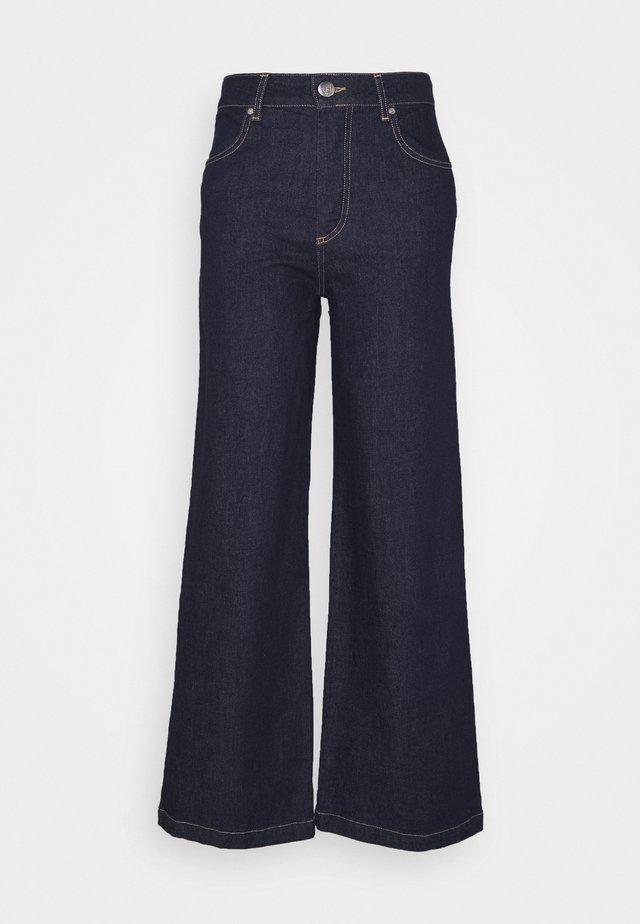 WINNIE - Flared Jeans - dark denim