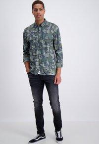 Junk De Luxe - Slim fit jeans - wash black - 0