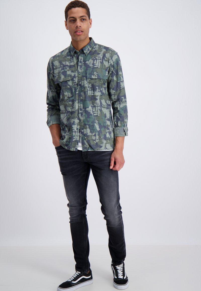 Junk De Luxe - Slim fit jeans - wash black
