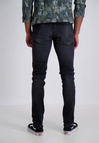 Junk De Luxe - Slim fit jeans - wash black - 1