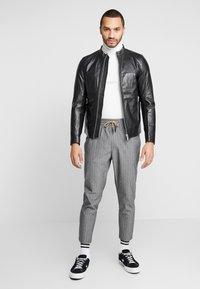 Junk De Luxe - RIDER JACKET - Leather jacket - black - 1