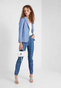Just Cavalli - LA PANTALONE - Slim fit jeans - denim - 1