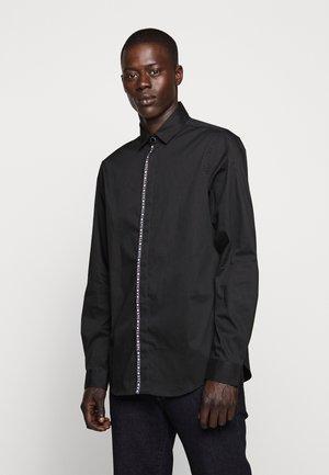 LOGO TAPING - Shirt - black