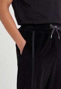 Just Cavalli - PANTS - Teplákové kalhoty - black - 5