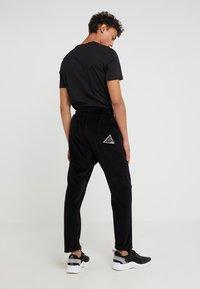 Just Cavalli - PANTS - Teplákové kalhoty - black - 2