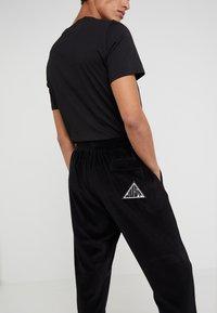 Just Cavalli - PANTS - Teplákové kalhoty - black - 3