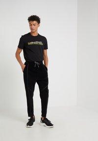 Just Cavalli - PANTS - Teplákové kalhoty - black - 1