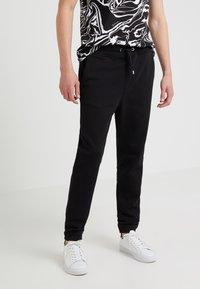 Just Cavalli - Pantalon de survêtement - black - 0