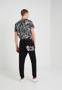 Just Cavalli - Pantalon de survêtement - black - 2