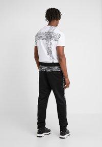 Just Cavalli - Pantalones deportivos - black - 2