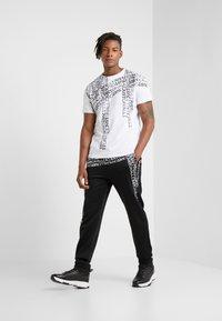 Just Cavalli - Pantalones deportivos - black - 1