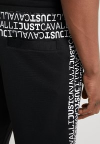 Just Cavalli - Pantalones deportivos - black - 5