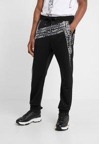 Just Cavalli - Pantalones deportivos - black - 0
