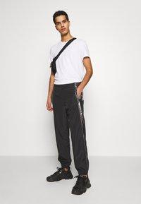 Just Cavalli - PANTS - Pantaloni sportivi - black/silver - 1