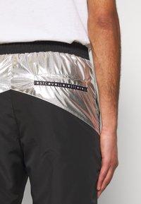 Just Cavalli - PANTS - Pantaloni sportivi - black/silver - 5