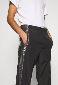 Just Cavalli - PANTS - Pantaloni sportivi - black/silver - 3