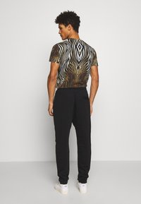 Just Cavalli - PANTS - Pantaloni sportivi - black - 2