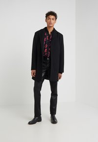 Just Cavalli - PANTS 5 POCKETS - Slim fit jeans - black - 1