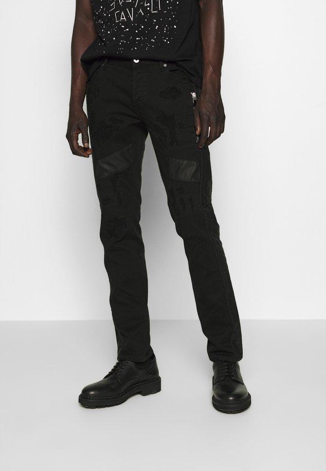 STRIPE PANTS - Slim fit -farkut - black