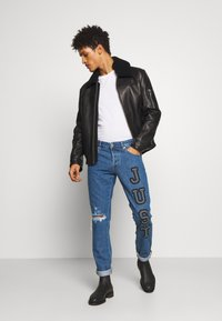 Just Cavalli - PANTS 5 POCKETS LOGO - Jeans slim fit - blue denim - 1