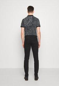 Just Cavalli - PANTS POCKETS BIKER - Slim fit jeans - black - 2