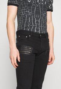 Just Cavalli - PANTS POCKETS BIKER - Slim fit jeans - black - 3