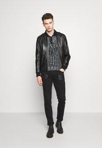 Just Cavalli - PANTS POCKETS BIKER - Slim fit jeans - black - 1
