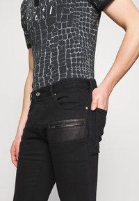Just Cavalli - PANTS POCKETS BIKER - Slim fit jeans - black - 4