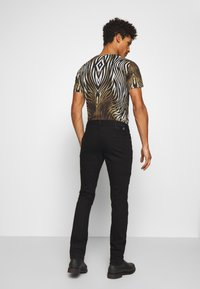 Just Cavalli - PANTS 5 POCKETS TAPING - Slim fit jeans - black - 2