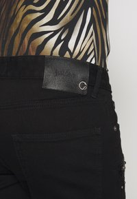 Just Cavalli - PANTS 5 POCKETS TAPING - Slim fit jeans - black - 5