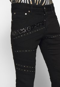 Just Cavalli - PANTS 5 POCKETS TAPING - Slim fit jeans - black - 3
