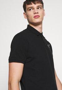 Just Cavalli - LOGO - Polo shirt - black - 3