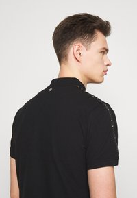 Just Cavalli - SIDE TAPING - Polo shirt - black - 3