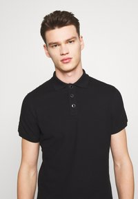 Just Cavalli - SIDE TAPING - Polo shirt - black - 5
