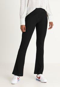 JDY - JDYCIM FLARED PANT - Leggings - black - 0