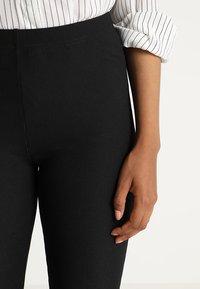 JDY - JDYCIM FLARED PANT - Leggings - black - 3