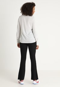 JDY - JDYCIM FLARED PANT - Leggings - black - 2