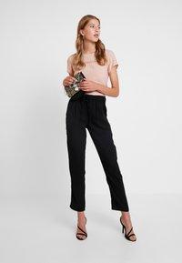 JDY - JDYNOBEL PANT - Trousers - black - 1