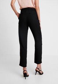 JDY - JDYNOBEL PANT - Trousers - black - 2
