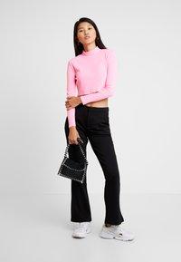 JDY - Spodnie materiałowe - black - 1