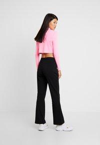 JDY - Spodnie materiałowe - black - 2