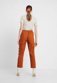 JDY - JDYCALLIE WORKER - Trousers - sugar almond - 2